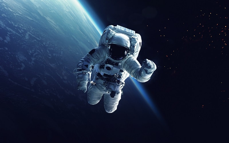 Astronaut in Space with Earth Behind