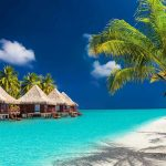 Maldives beach with Huts - Business Class Flights to Maldives - Just Fly Business