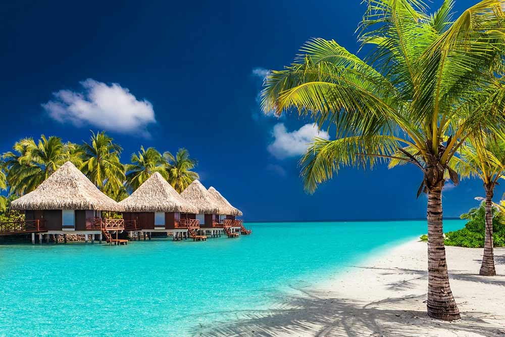 Maldives beach with Huts - Your Next First Class Destination - Just Fly Business