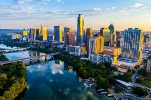 View of the city skyline and Colorado River in Austin Texas at sunset