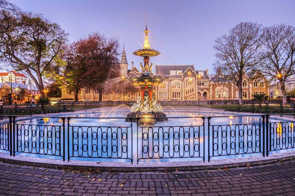 Peacock Fountain at dusk in Christchurch - Your Next Business Class Destination | Just Fly Business