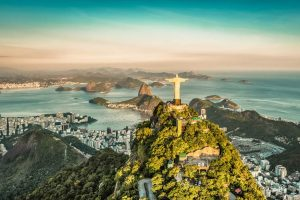 Christ the Redeemer Statue at Sunset Overlooking Rio de Janeiro - Your Next Business Class Destination | Just Fly Business
