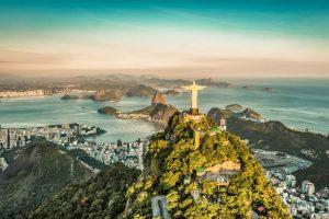 Christ the Redeemer Statue at Sunset Overlooking Rio de Janeiro - Your Next Business Class Destination | Just Fly Business