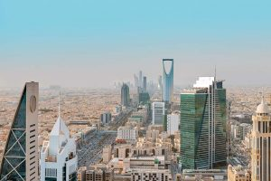 Riyadh city skyline with skyscrapers in a dust haze | Just Fly Business