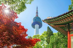 Seoul Tower with a Temple and Autumn Leaves - Your Next Business Class Destination | Just Fly Business
