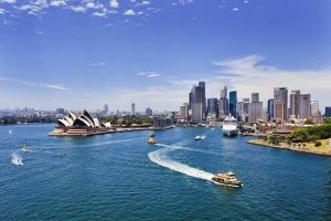 Sydney Harbour with the Opera House and Ferry - First & Business Class Flights Destination | Just Fly Business