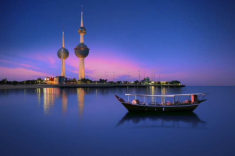 Kuwait Towers at Night with boat