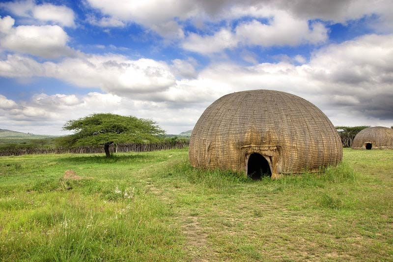 Traditional Zulu Hut in grassland near Durban, South Africa