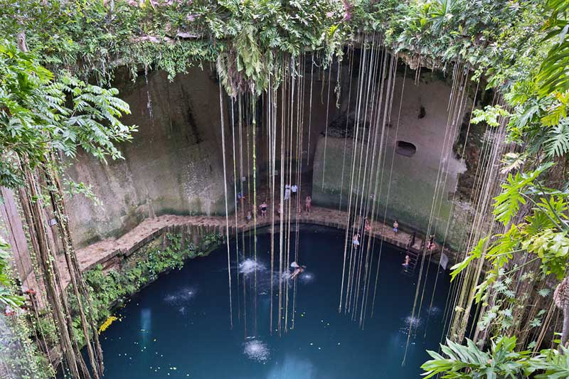 Swimming at Cenote Ik Kil in Cancun, Mexico - Just Fly Business