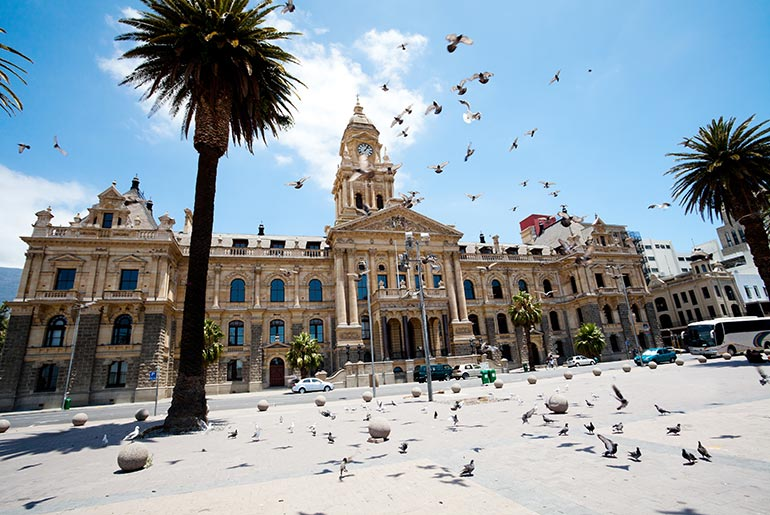 front view of City Hall, Cape Town, with birds flying in the sky
