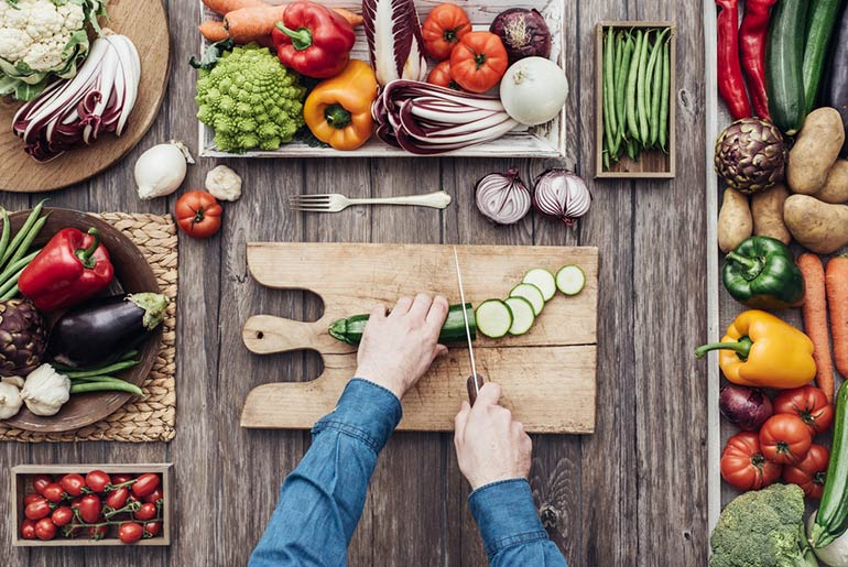 Chopping Vegetables on Wooden Board - Just Fly Business