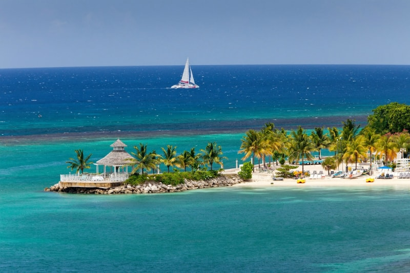 Beach Pavilion and sailboat in Montego Bay Jamaica