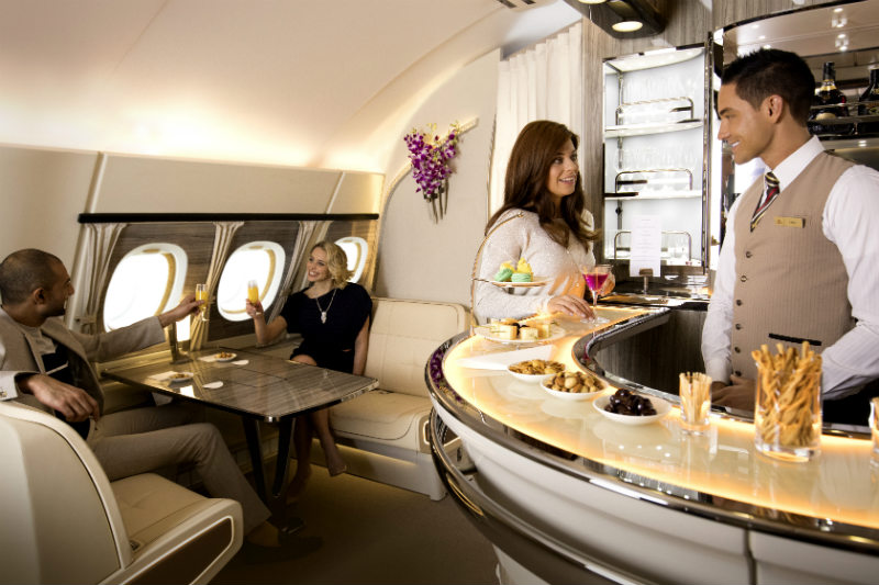 Passengers enjoying themselves in the Emirates A380 onboard lounge area
