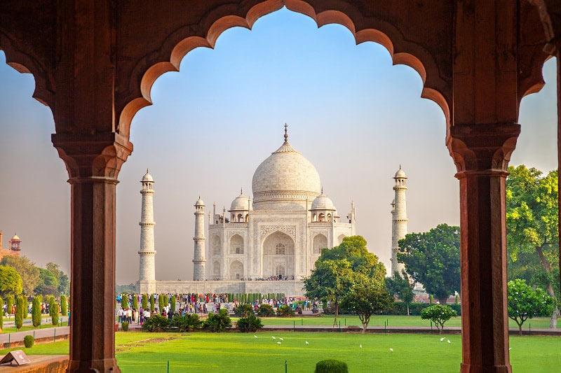 Taj Mahal through an arch in Agra, India
