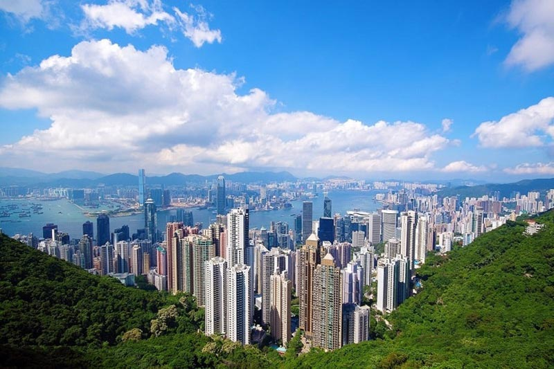 View from Victoria Peak with clouds and city skyline in Hong Kong, China