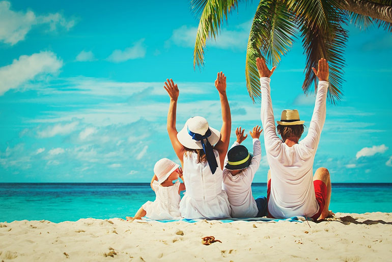 Family on the Beach - Summer Family Holiday | Just Fly Business
