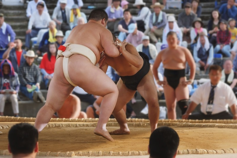 Sumo Wrestlers Fighting in Stadium in Japan