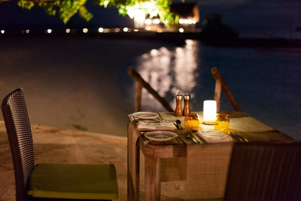 Candlelit Table in Restaurant at Constance Moofushi Maldives