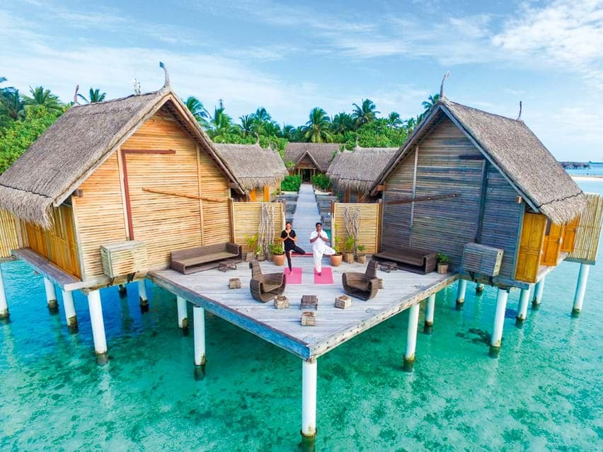 Morning Yoga over water at Constance Moofushi Maldives