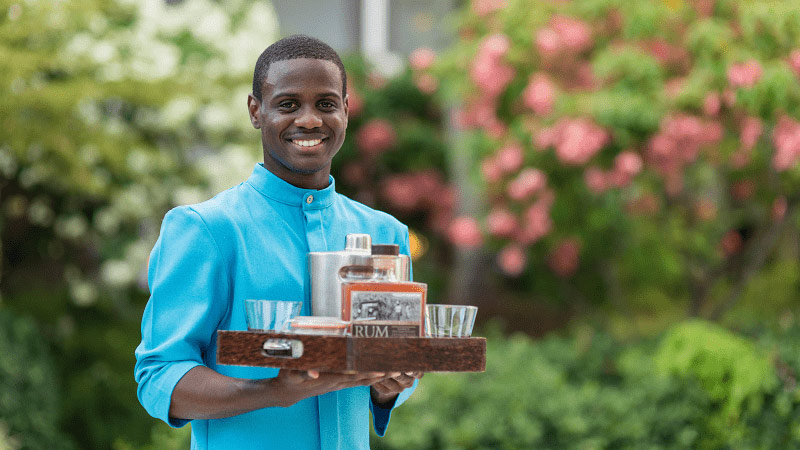 Waiter Serving Rum - Luxury Holiday at The Colony Club - Just Fly Business