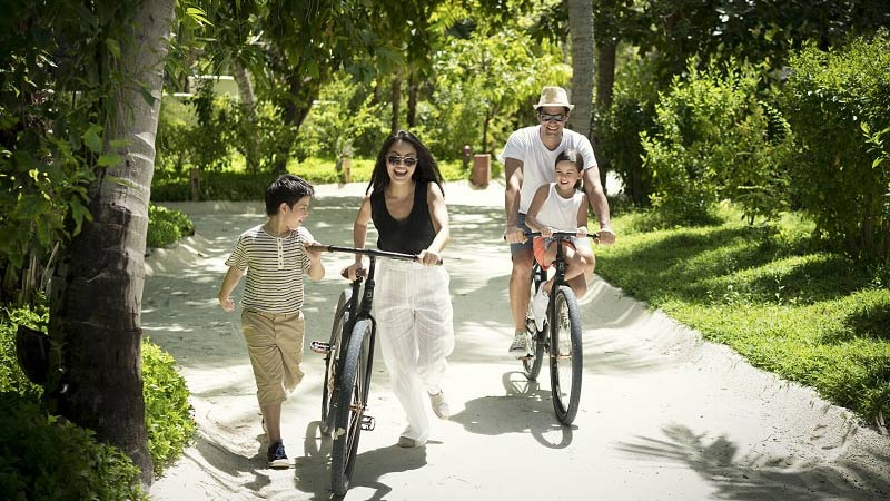 Family on Bicycles - Luxury Holiday at Anantara Dhigu Resort Maldives - Just Fly Business