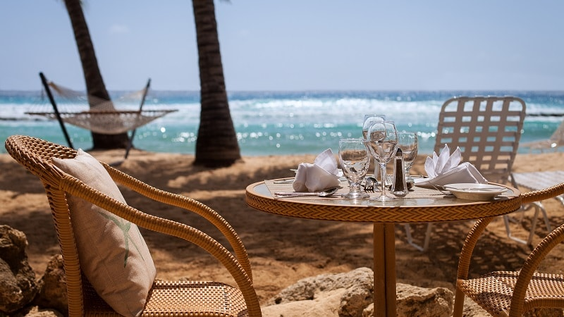 table and chairs with beach view