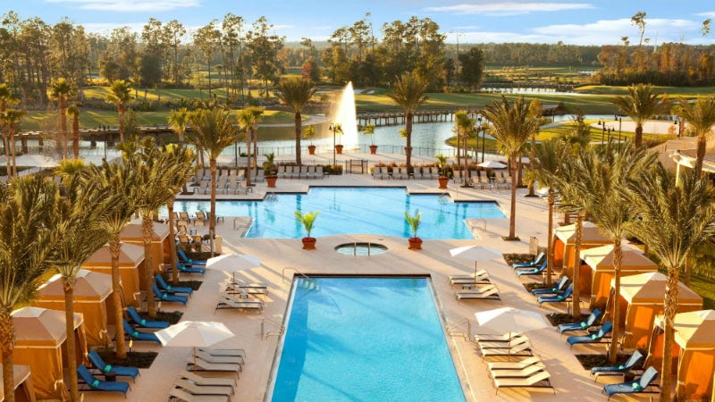 Outdoor Resort Pool - Luxury Holiday at Waldorf Astoria | Just Fly Business