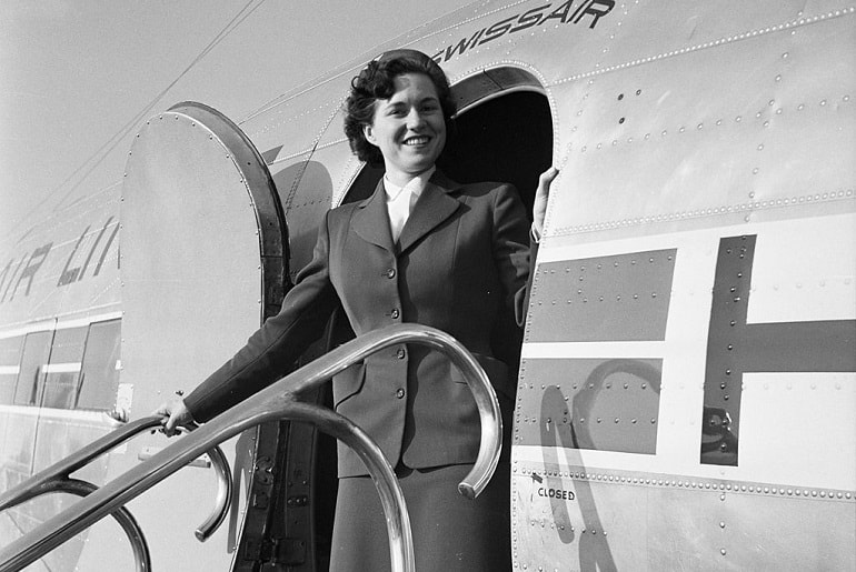 Swiss Air Hostess 1953 at plane door
