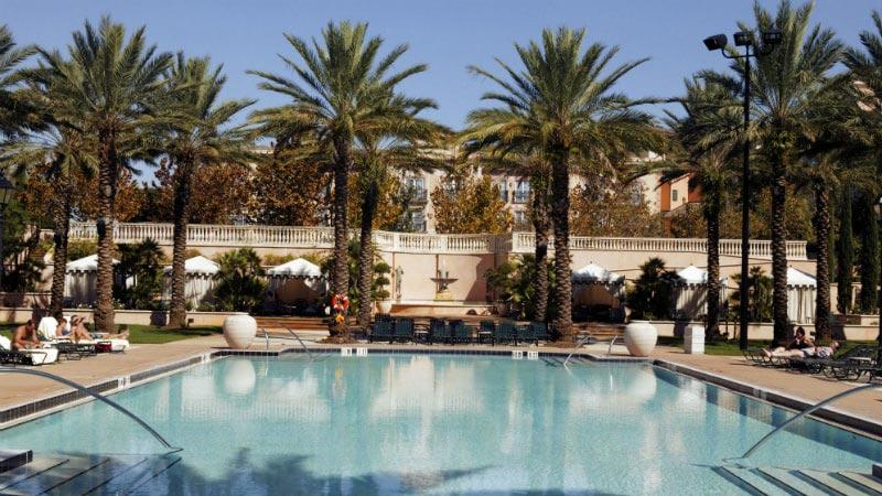 The villa pool with palm trees at Loews Portofino Bay Hotel in Orlando