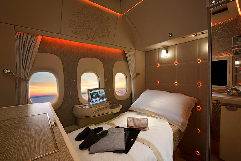 Emirates First Class Suite shown in low light