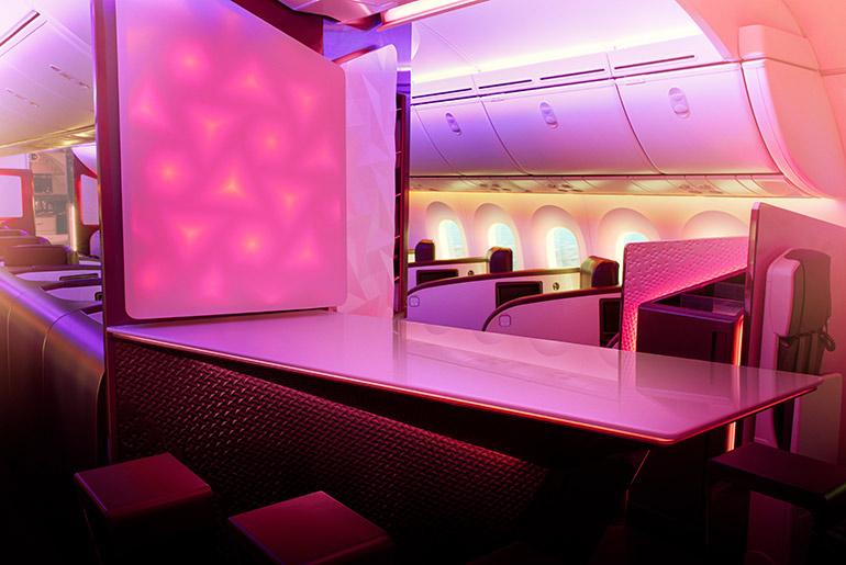 two men sitting and talking in Virgin Atlantic Upper Class on-board bar