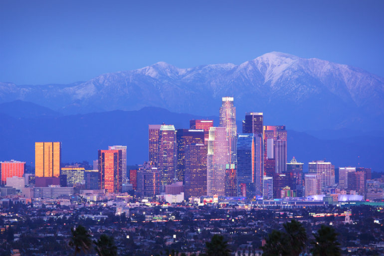Downtown Los Angeles skyline with snowy mountains, USA