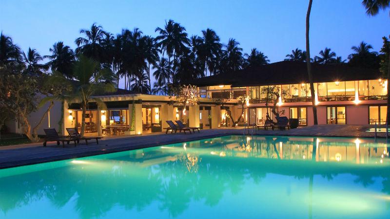 Evening View across the swimming pool of the Hotel at Avani Kalutara Resort, Sri Lanka
