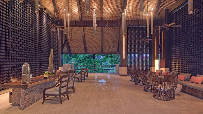 Reception area with wood features at Fairmont Sanur Beach Hotel in Bali