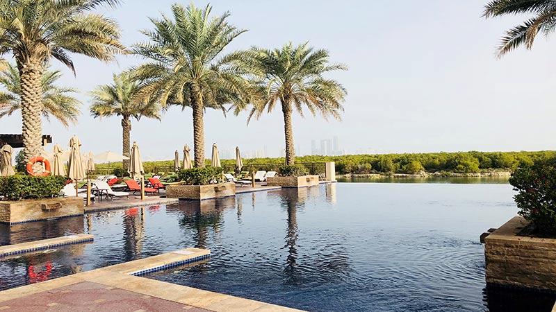 Pool side view with Abu Dhabi skyline - Anantara Eastern Mangroves Resort, Abu Dhabi