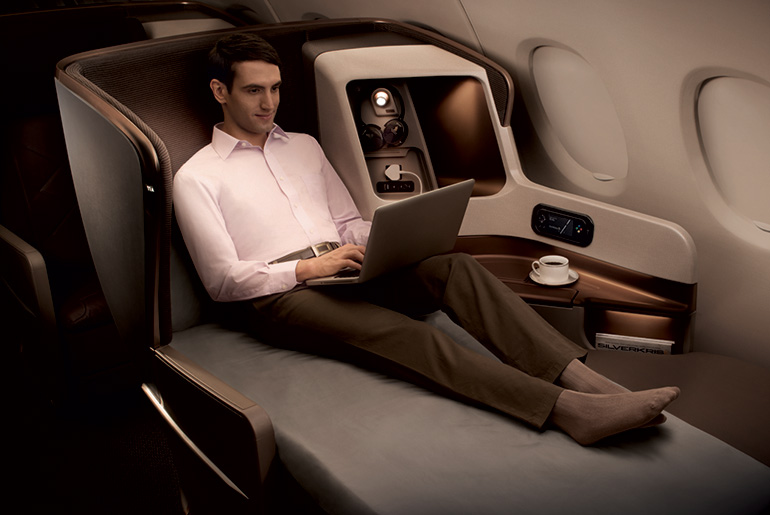 Man seated in Singapore Airlines business class seat