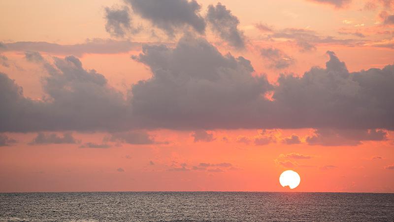 Sunset view over water at Avani Kalutara Resort, Sri Lanka