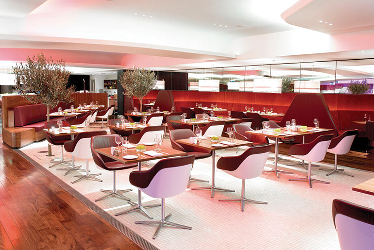 People dinning in the Virgin lounge - Virgin Upper Class Clubhouse