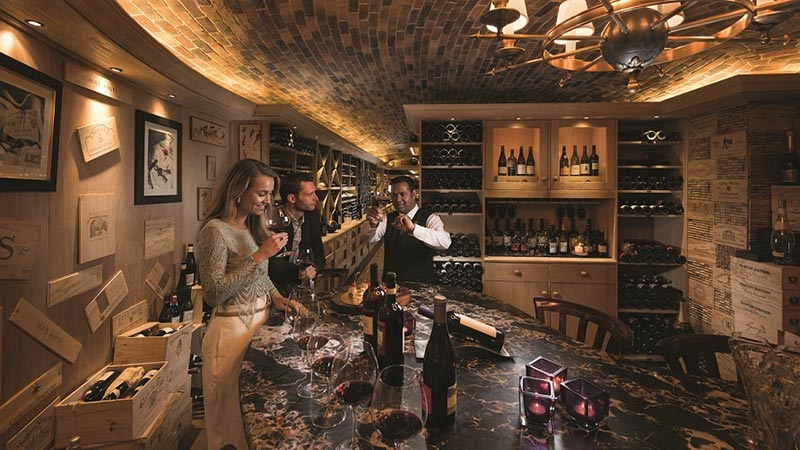 Couple trying wine in the wine cellar at Constance Prince Maurice in Mauritius