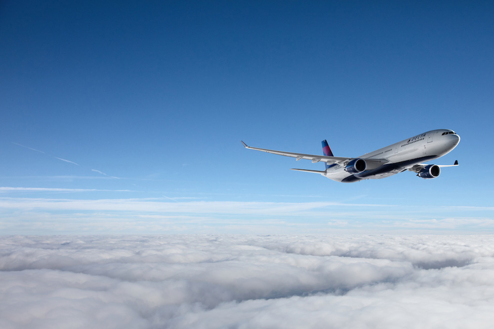 Delta's Airbus A330 containing Delta One Business Class flying over clouds