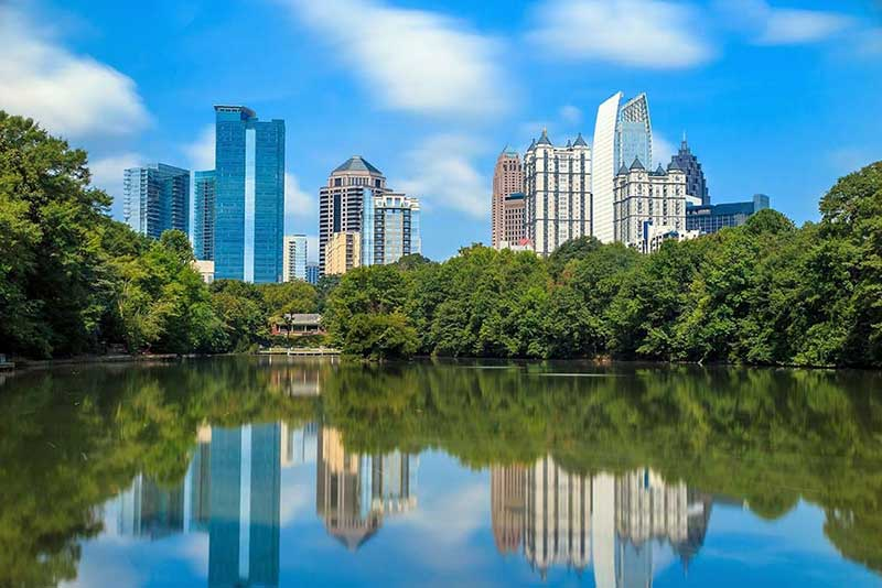 Atlanta city skyline reflected in a lake. A Delta One Business Class Destination