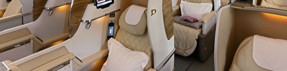 Business class seats and cabin in Emirates 777-300ER