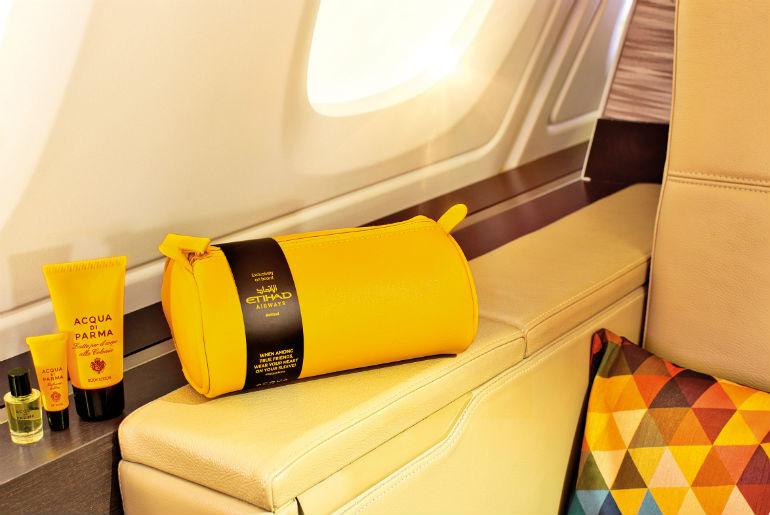 A bright yellow amenity kit by Acqua Di Parma in Etihad's first class cabin