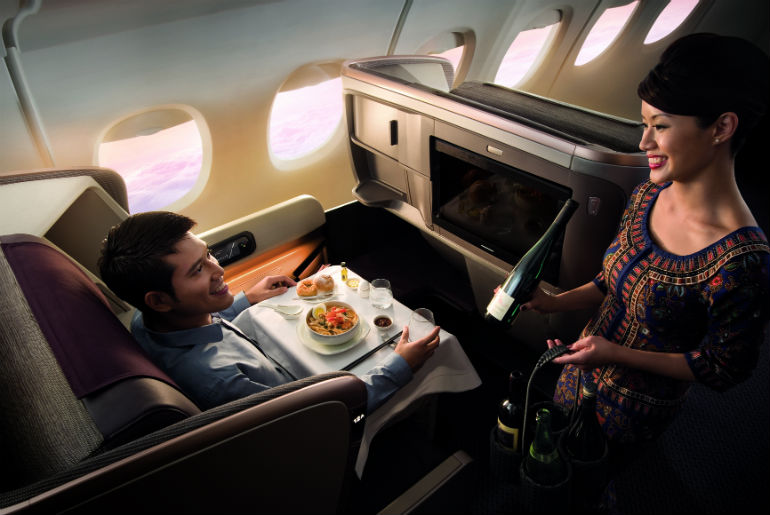 Flight service in a business class Singapore Airlines seat