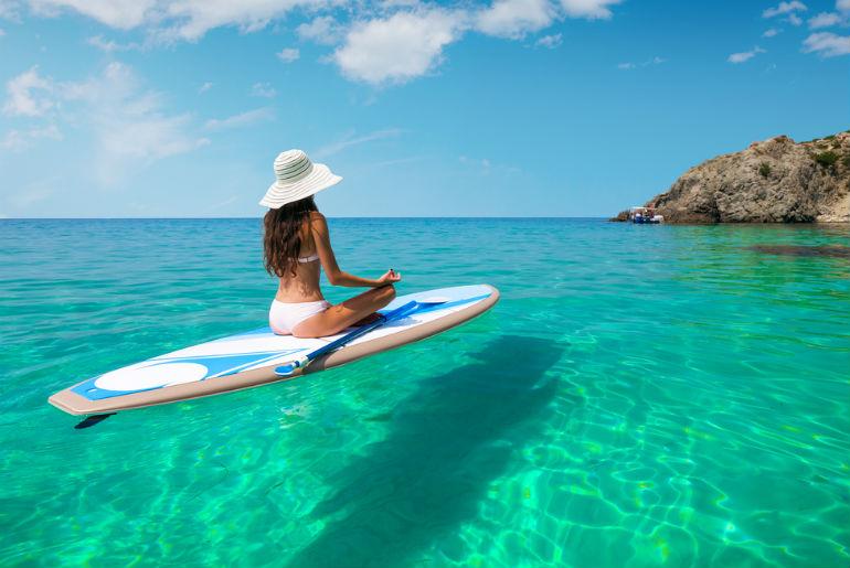 A lady on a surf board in the Hawaiian sea