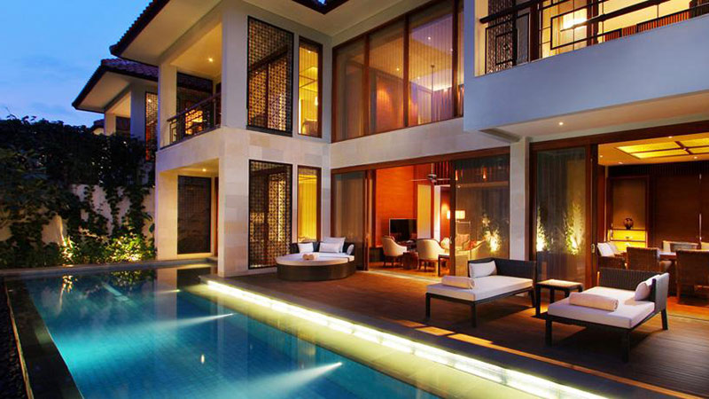 Private outdoor pool with lights at night of the Three Bedroom Pool Villa at the Fairmont Sanur Beach, Bali