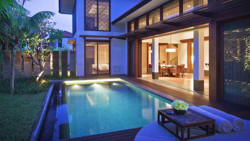 Private outdoor pool with lights at night of the Two Bedroom Pool Villa at the Fairmont Sanur Beach, Bali
