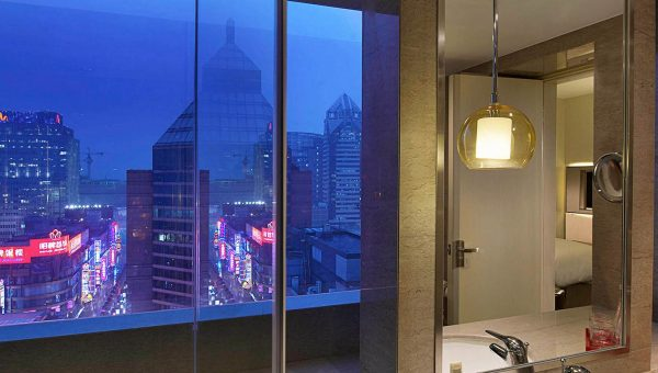 Bathroom Window at the Sofitel Shanghai Hyland looking over the Shangha skyline at night
