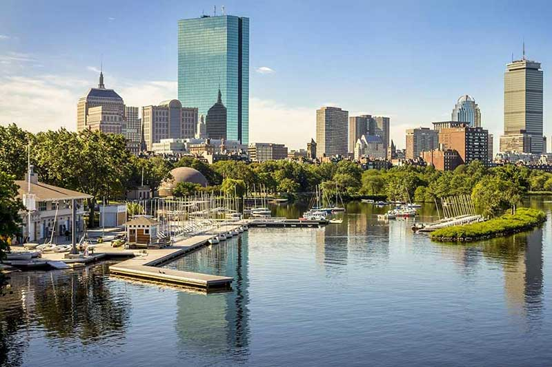 A wide shot of Boston's iconic harbour and city buildings