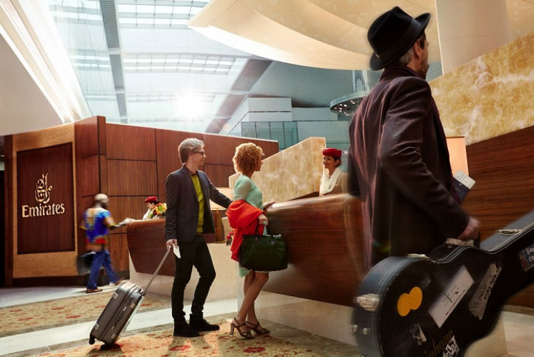 Emirates first & business class check-in fast track desk with passengers going through